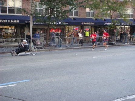 20071104-ny-marathon-17-wheelchair-racer-with-running-escort.jpg