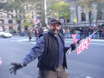 20071111-veterans-day-parade-43-vietnam-vet-handing-out-flags.jpg
